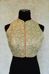 Shop this Indian designer sleeveless blouse from our store in USA or online from Pure Elegance. It is perfect for any wedding. High neck trendy Bollywood fashion. High Neck Blouse.
