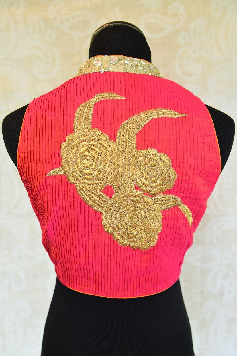 Shop this Indian designer sleeveless blouse from our store in USA or online from Pure Elegance. It is perfect for any wedding. High neck trendy Bollywood fashion. Golden Patch Work.