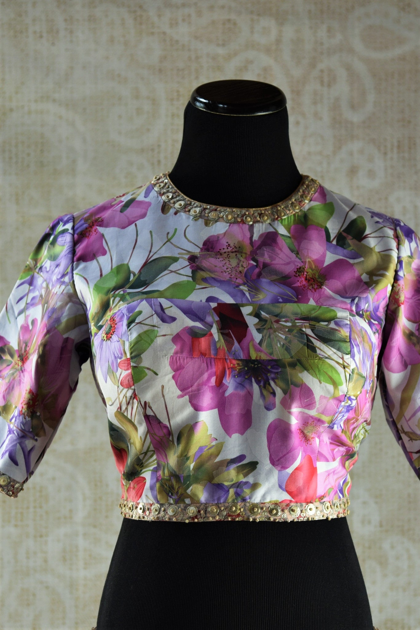 Buy Indian ethnic fashion online at Pure Elegance or our shop in Edison. Floral designer blouse with three-fourth sleeves perfect for any wedding party or sangeet. Front View.