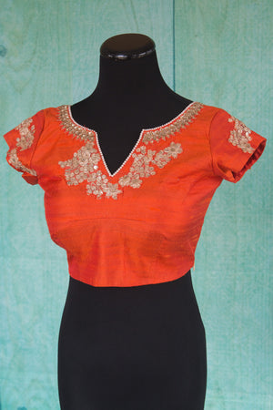 Buy this orange floral designer blouse perfect for any wedding party or reception from Pure Elegance or our store in USA. Deep neck short sleeved Bollywood fashion. Floral Print.