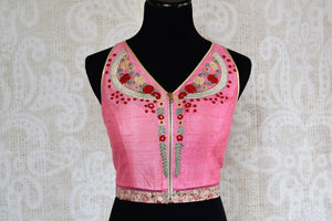 Shop the stunning ethnic Indian sleeveless designer blouse from Pure Elegance online or from our store in USA. Thread work perfect for any wedding or reception. -front