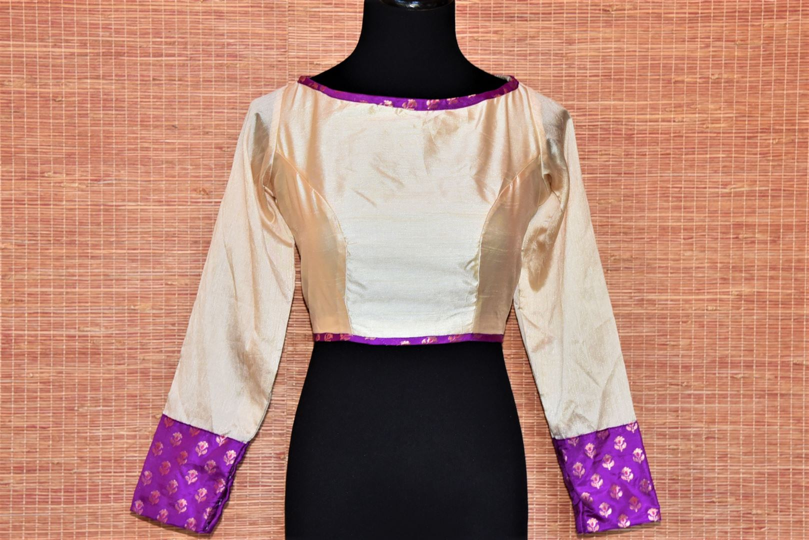 Shop elegant cream Banarasi silk saree blouse online in USA with full sleeves. Look captivating in Indian sarees matched with exquisite readymade sarees blouses from Pure Elegance Indian fashion boutique in USA.-front