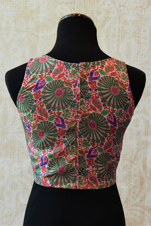 Buy this traditional Indian cotton silk designer blouse from Pure Elegance online or from our store in Edison. It is perfect for any wedding or reception party. Back View.