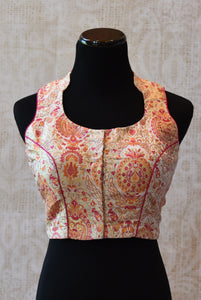 Buy this crop top styled sleeveless cotton printed Indian traditional designer blouse from Pure Elegance online or from our store in USA. Perfect for any sangeet. Sleeveless.