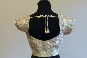 Buy this Indian designer silk blouse with gold embroidery online or at our Pure Elegance store in Edison. Semi sleeved saree blouse is Ideal for any sangeet party. Sexy Back.