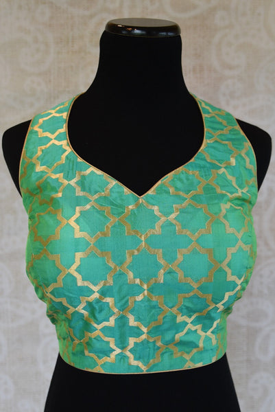 Shop this Indian ethnic Bollywood style designer green blouse from Pure Elegance store in Edison or buy it online. Perfect for any wedding party or reception. Green Blouse.