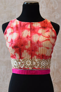 Buy this bollywood style traditional Indian sari blouse online or from our Pure Elegance store near NYC. The Crop top blouse is ideal for any prom or baby shower. Pink and White Blouse.