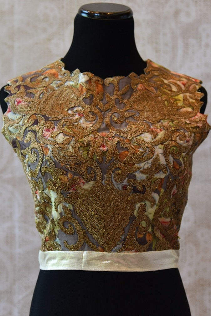 Shop this designer silk crop top blouse from Pure Elegance store near NYC or online. The gold embroidered net blouse is perfect for any wedding or engagement. Crop Top Blouse.