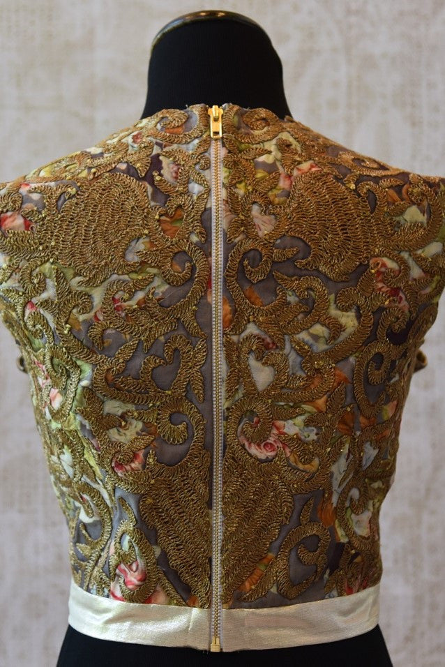 Shop this designer silk crop top blouse from Pure Elegance store near NYC or online. The gold embroidered net blouse is perfect for any wedding or engagement. Silk Blouse.