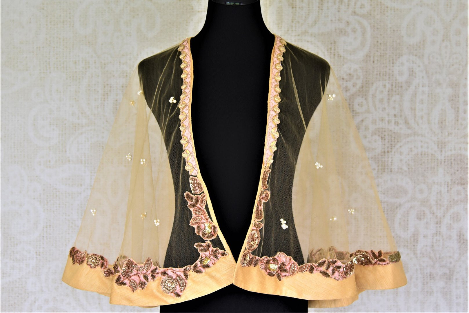 Shop cream hand embroidered net designer cape blouse online in USA. Complete your ethnic saree look with designer blouses, readymade sari blouse, embroidered saree blouse from Pure Elegance Indian saree store in USA.-FRONT