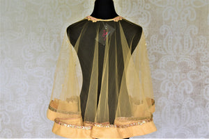 Shop cream hand embroidered net designer cape blouse online in USA. Complete your ethnic saree look with designer blouses, readymade sari blouse, embroidered saree blouse from Pure Elegance Indian saree store in USA.-back