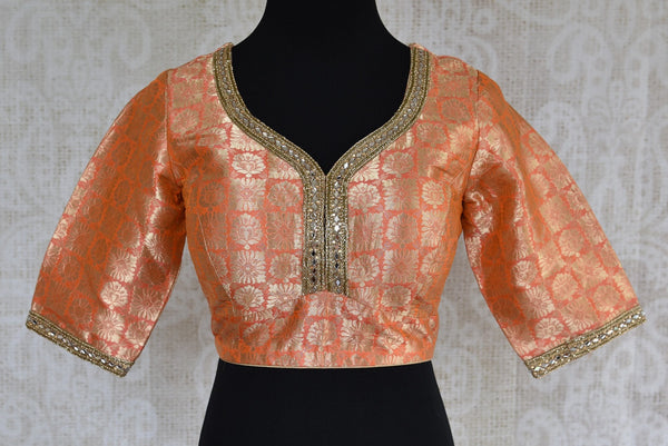 Shop this Indian ethnic orange blouse having stone work on neck and sleeves online or from our store in USA. It is perfect for any engagement or wedding party. Orange Blouse.