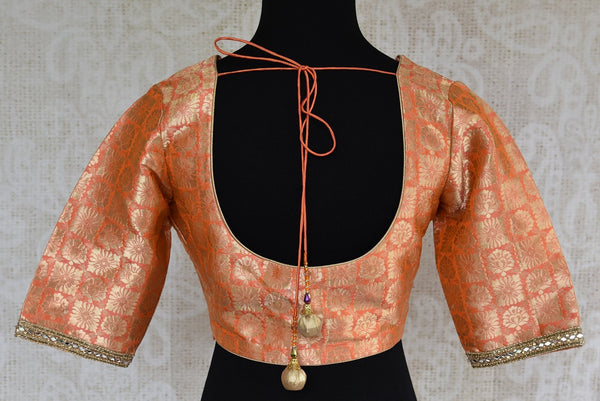 Shop this Indian ethnic orange blouse having stone work on neck and sleeves online or from our store in USA. It is perfect for any engagement or wedding party.  Round Back.