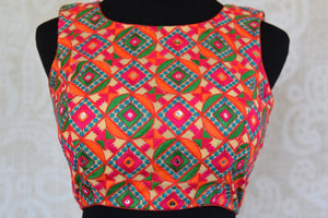 Shop this Indian ethnic crop top style designer blouse with cotton embroidery from Pure Elegance store online or from our shop near NYC. Ideal for any wedding. Crop Top Blouse.