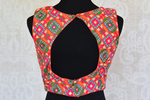 Shop this Indian ethnic crop top style designer blouse with cotton embroidery from Pure Elegance store online or from our shop near NYC. Ideal for any wedding. Sexy Back.