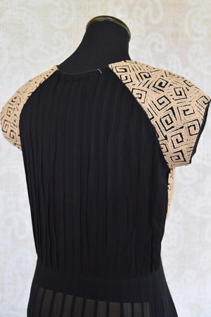 Buy this ethnic Indian black and golden dress online or from our Pure Elegance store in USA. The Bollywood-inspired dress is ideal for any wedding or reception. Back View.