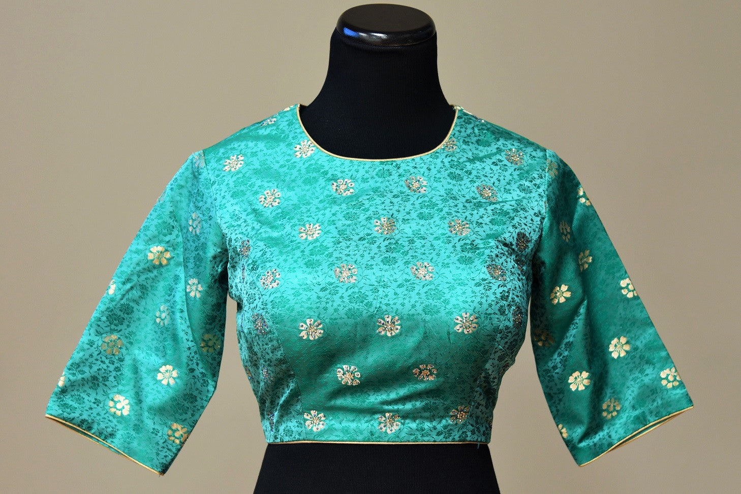 Shop this ethnic Indian tanchoi silk designer blouse with gold trim online or from our Pure Elegance store in USA. It is perfect for any wedding or reception. Green Blouse.