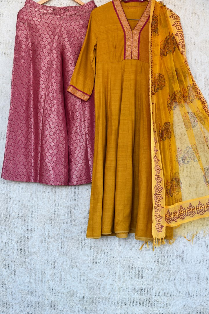 Buy ethnic mustard yellow kurta with Banarasi palazzo online in USA. Exquisite collection of Indian designer suits at Pure Elegance online store in USA. Shop online.-full view
