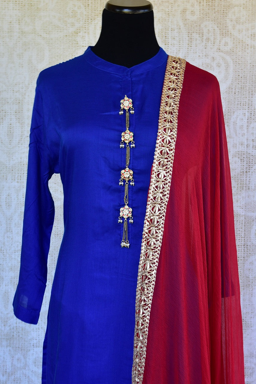 Shop this ethnic Indian red and blue rayon two piece dress ideal for any engagement or birthday party from Pure Elegance online or from our store in Edison NJ. Close up.