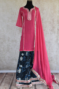 Shop this ethnic Indian floral red and blue ghagra set online or from our Pure Elegance store near NYC. It is perfect for any wedding party or pooja occasion. Front View