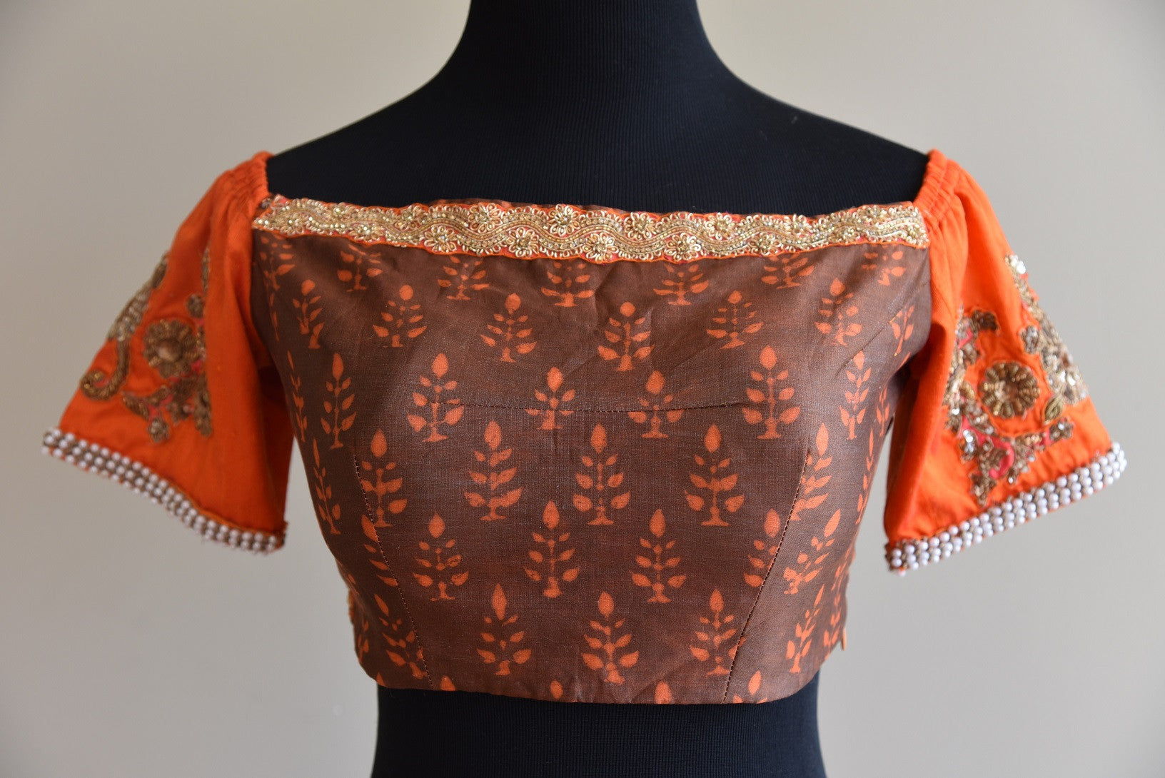 Shop this Indian traditional Cotton Silk Printed Blouse with Silk Sleeves online or Pure Elegance store in USA. It is ideal for any wedding or reception party. Boatneck Blouse.