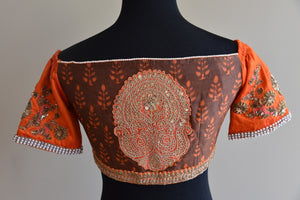 Shop this Indian traditional Cotton Silk Printed Blouse with Silk Sleeves online or Pure Elegance store in USA. It is ideal for any wedding or reception party. Orange Blouse.