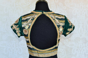 Shop this Indian traditional green embroidered velvet designer blouse online and from  Pure Elegance store in USA. Perfect for any wedding or reception party. Cut Out.