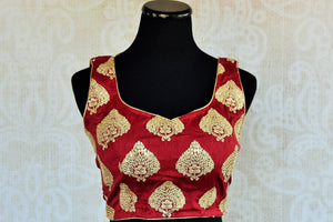 Buy this Indian traditional matka silik designer blouse online as well as at our shop in Edison. Sleeveless low neck maroon blouse perfect for any wedding or prom. Front View.
