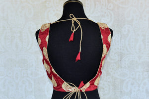 Buy this Indian traditional matka silik designer blouse online as well as at our shop in Edison. Sleeveless low neck maroon blouse perfect for any wedding or prom. Back View.