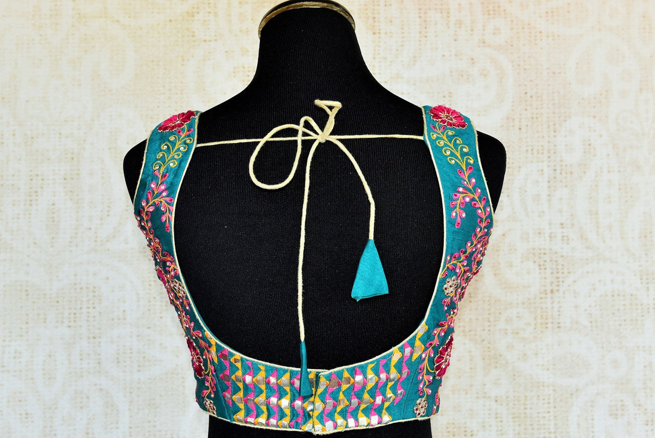 Buy this Indian traditional cotton silk designer foil work blouse from our Pure Elegance store in USA or online. Perfect for any engagement party or sangeet. Back View.