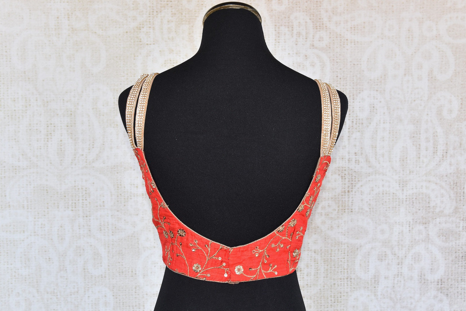 Buy this Indian traditional red sleeveless deep neck designer blouse perfect for any sangeet party or reception from Pure Elegance online or at our store in USA. Back View.