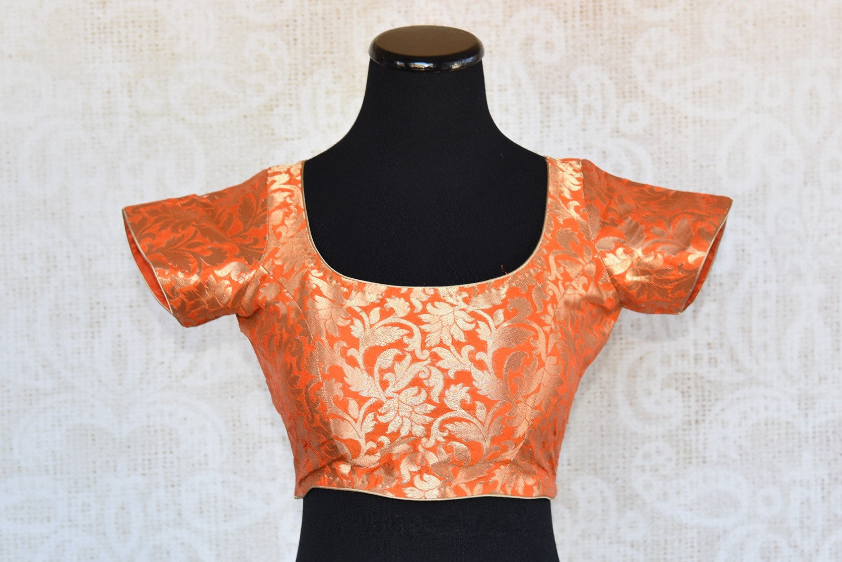 Buy this orange semi-sleeved ethnic pre-stitched designer crop top blouse perfect for any wedding or pooja from Pure Elegance online or from our store near NYC. Front View.