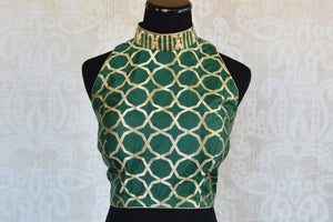 Shop this traditional Indian benarasi halter neck sleeveless designer blouse perfect for any wedding or reception online or from our Pure Elegance store in USA.  Front View.