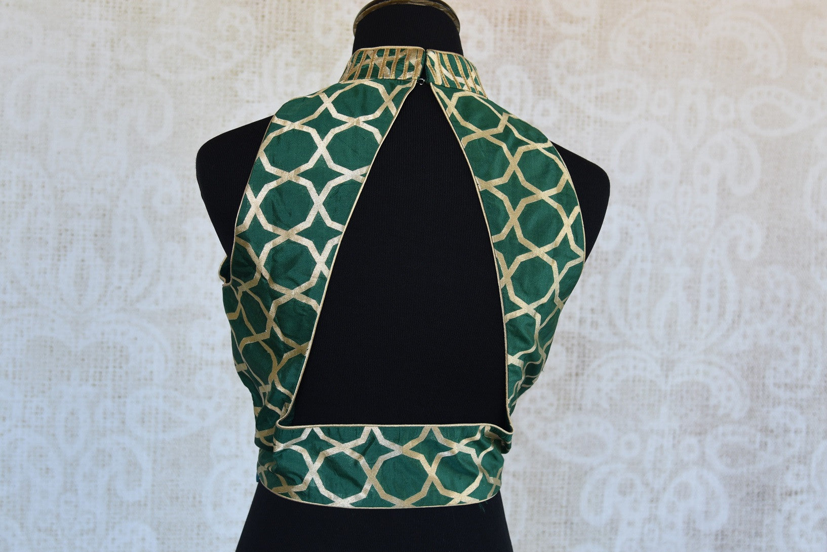 Shop this traditional Indian benarasi halter neck sleeveless designer blouse perfect for any wedding or reception online or from our Pure Elegance store in USA. Back Slit.