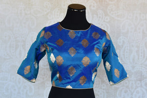 Shop this Indian traditional blue banarasi blouse from Pure Elegance online or from our store in Edison near NJ. It is ideal for any wedding or reception party. Front View.