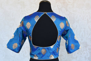Shop this Indian traditional blue banarasi blouse from Pure Elegance online or from our store in Edison near NJ. It is ideal for any wedding or reception party. Back Slit.