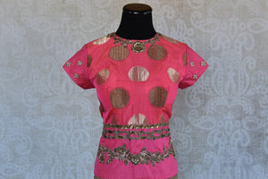 Shop this traditional Indian pink embroidered banarasi blouse from Pure Elegance online or from our store in Edison near NJ. Ideal for any wedding or sangeet.  Front View.