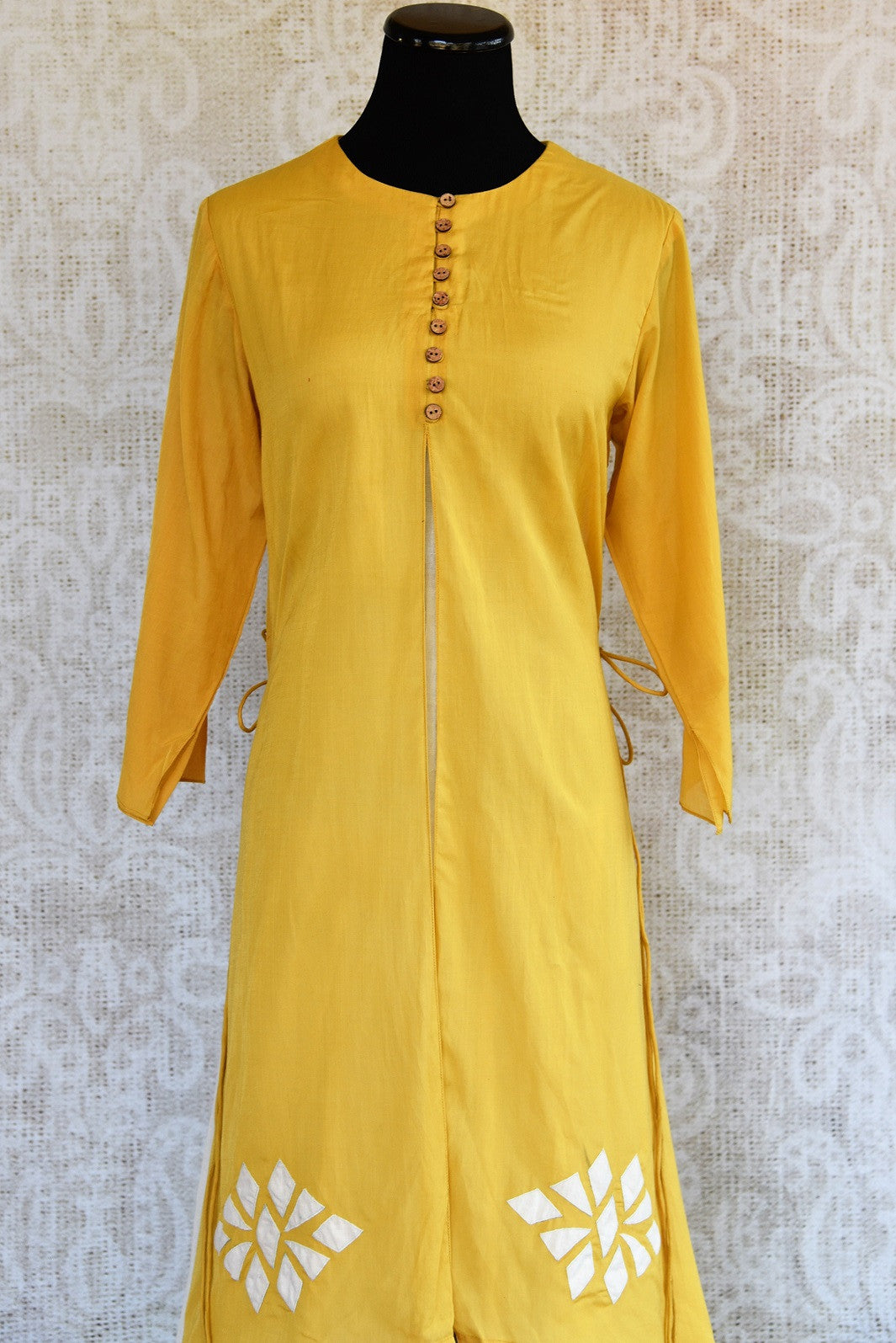 Buy this mustard Indo western yellow and white Indian ethnic dress online from our Pure Elegance store in USA. It is perfect for any wedding or reception party. Close up.