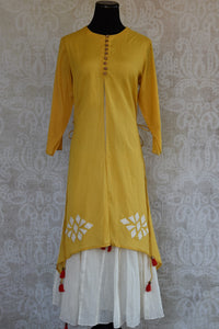 Buy this mustard Indo western yellow and white Indian ethnic dress online from our Pure Elegance store in USA. It is perfect for any wedding or reception party. Front View.