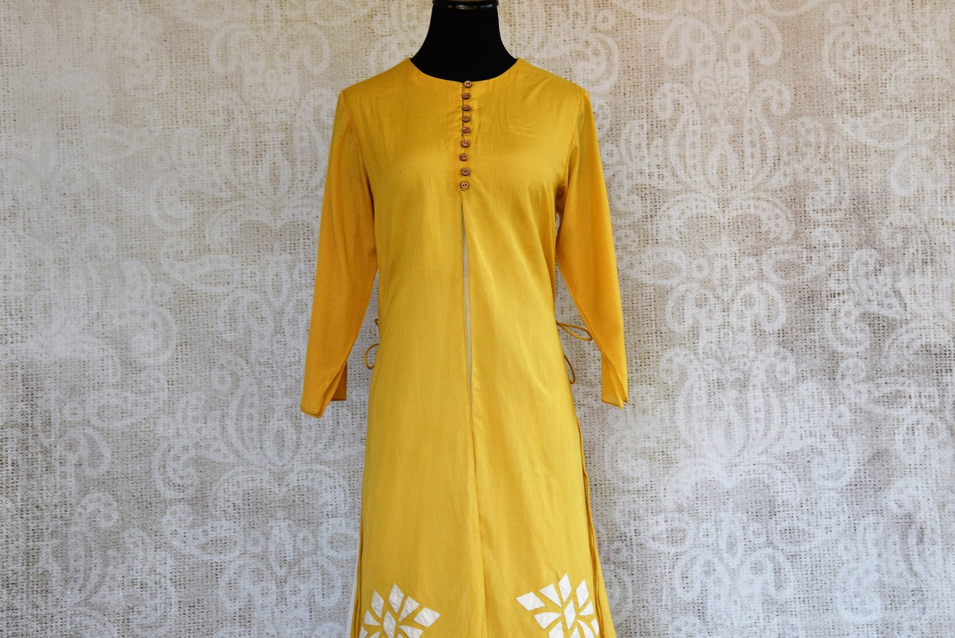 Buy this mustard Indo western yellow and white Indian ethnic dress online from our Pure Elegance store in USA. It is perfect for any wedding or reception party. Top View.
