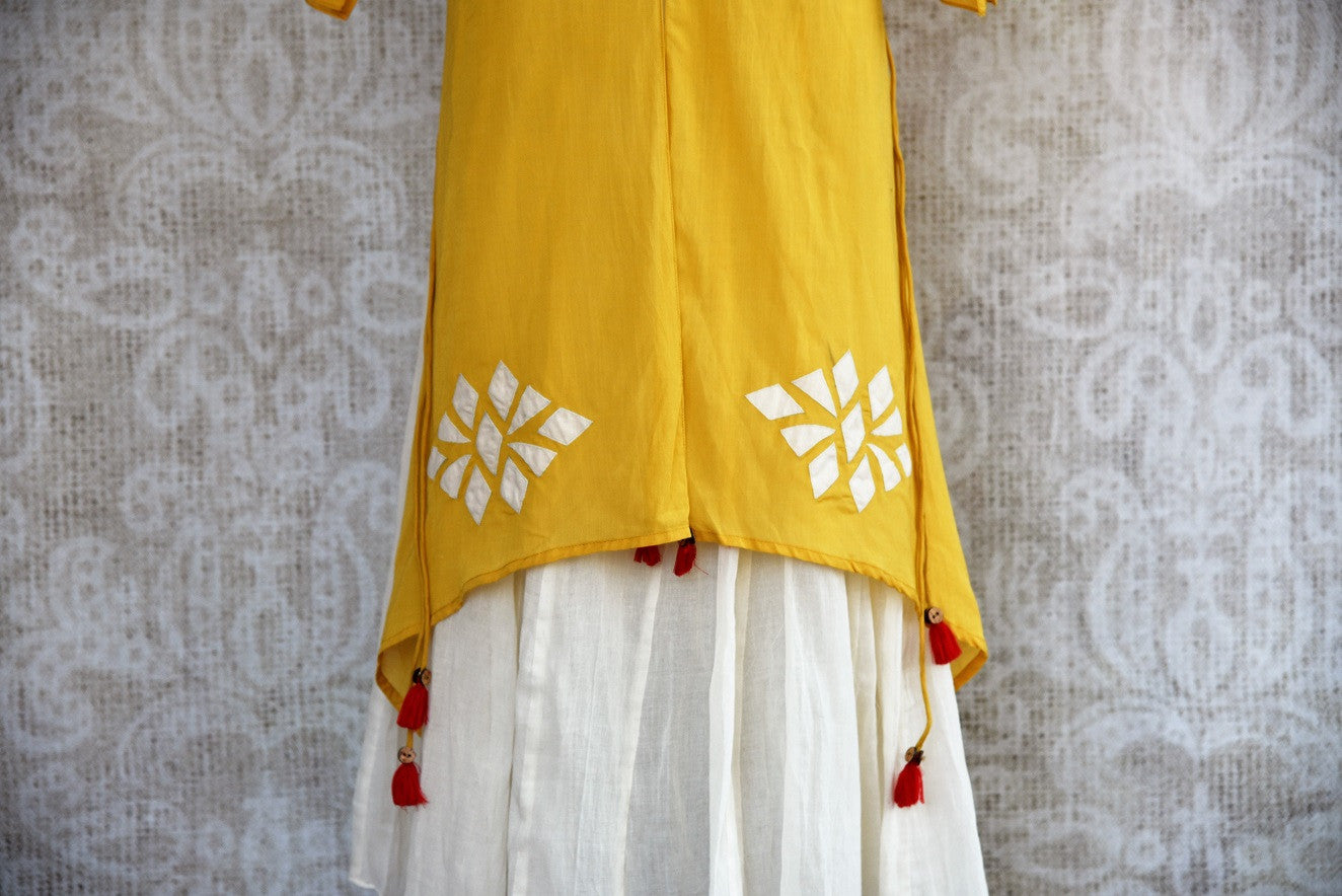 Buy this mustard Indo western yellow and white Indian ethnic dress online from our Pure Elegance store in USA. It is perfect for any wedding or reception party. White and Yellow.