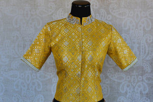Buy this Indian traditional yellow silk embroidered designer banarasi blouse ideal for any puja or baby shower from Pure Elegance online or at our store in USA. Front View.