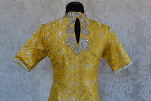 Buy this Indian traditional yellow silk embroidered designer banarasi blouse ideal for any puja or baby shower from Pure Elegance online or at our store in USA. Back View.