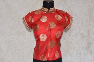 Shop this traditional Indian orange high neck embroidered blouse from Pure Elegance online or from our store in USA. Perfect for any wedding or reception party. Front View.