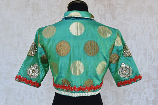 Buy this Indian traditional embroidered high neck designer blouse from Pure Elegance online or from our store near NYC. Ideal for any sangeet or reception party. Back View.