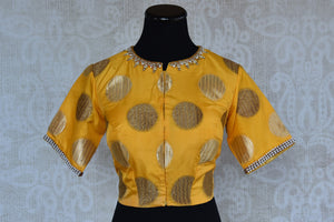 Buy this traditional Indian yellow banarasi designer blouse from Pure Elegance perfect for any sangeet party or puja available online or from our store in USA. Front View.