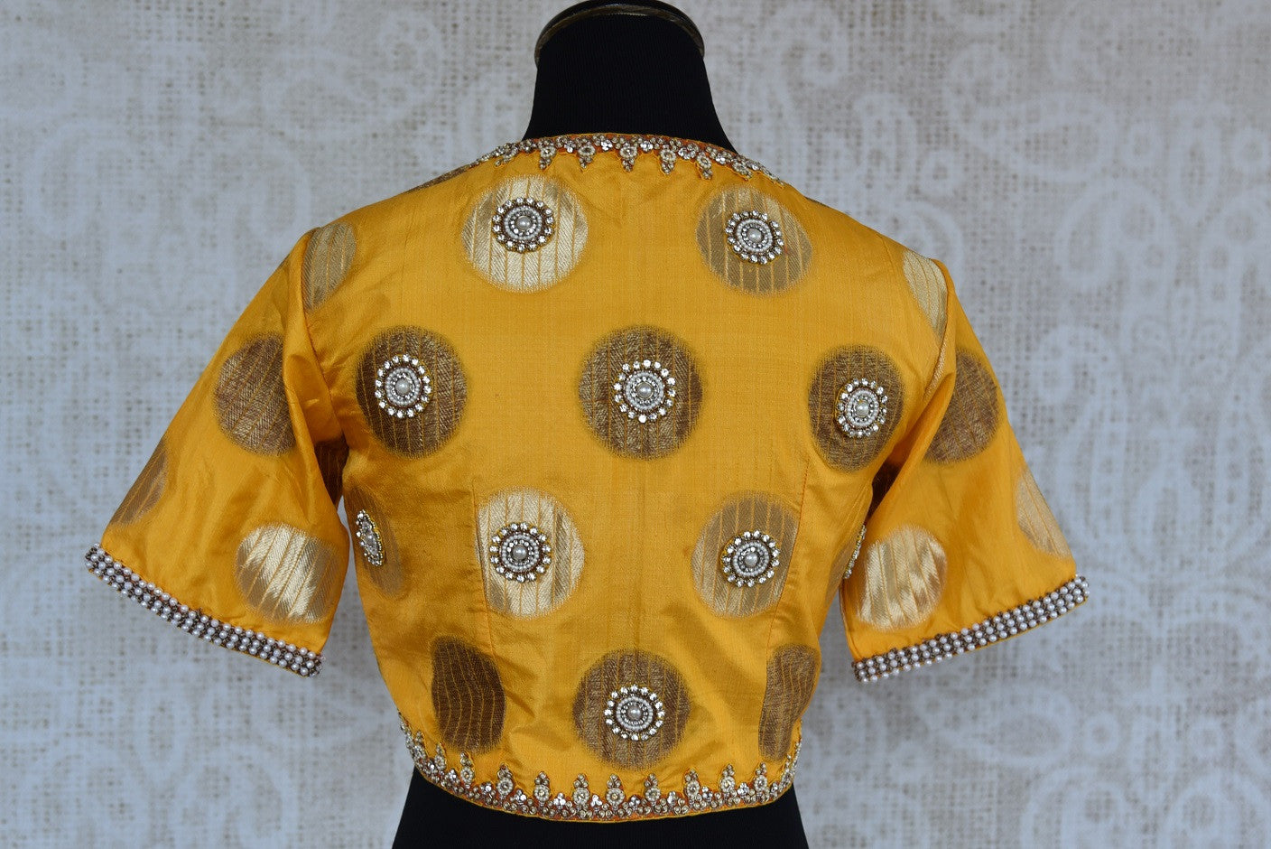 Buy this traditional Indian yellow banarasi designer blouse from Pure Elegance perfect for any sangeet party or puja available online or from our store in USA. Back View.