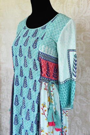 Buy traditional blue cotton silk printed dress online or from our Pure Elegance store in USA. We bring you a range of latest Indian dresses online for every occasion.-top side view