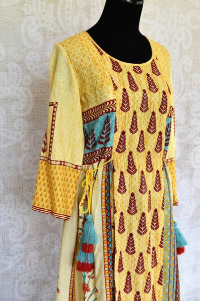 Buy this ethnic yellow cotton silk printed dress online or from our Pure Elegance store in Edison near NJ. We bring you stylish Indian dresses online in USA for every occasion.-top side view