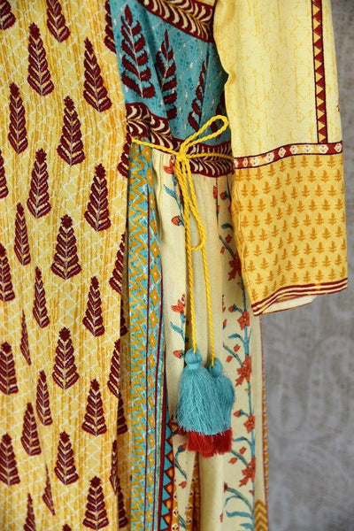 Buy this ethnic yellow cotton silk printed dress online or from our Pure Elegance store in Edison near NJ. We bring you stylish Indian dresses online in USA for every occasion.-details
